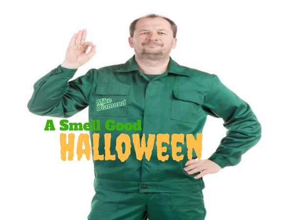 """plumber in green uniform with """"Mike Diamond"""" logo on right pocket making """"three-oh"""" sign"""