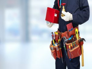 plumber with extensive tool belt