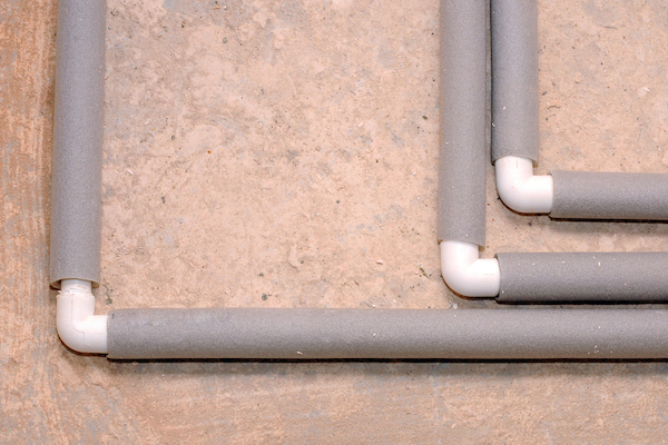 Pipes wrapped in grey insulation