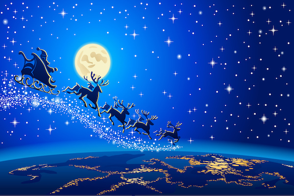 Santa, sleigh, and reindeer flying high over the earth in blue night's sky, with lights from city beneath them and moon overhead