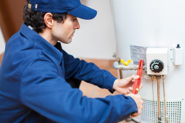 plumbing technician installing a water heater