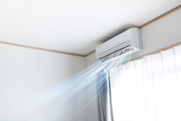 Wall air conditioner unit blowing cool air into home