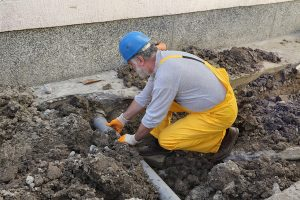 Expert plumber fixing a sewer line