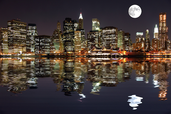 Shot of New York skyline at night as seen from the Hudson river. Featuring Cosmo's Moon.