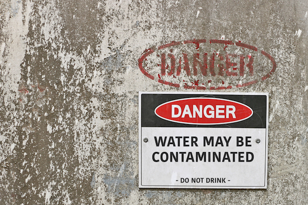 """Danger: Water may be contaminated"" sign"