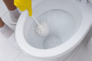 Clean the jets under the toilet rim to increase the strength of your flush