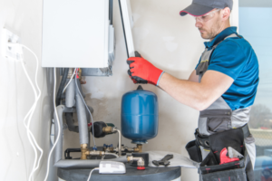 Professional installing a gas furnace