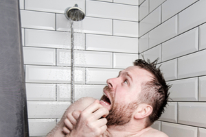 Man running out of hot water during a shower