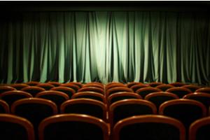 A dark movie theater interior.